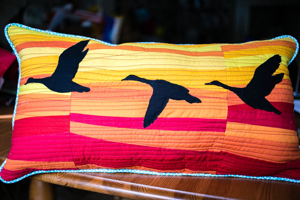 Improv Quilted Geese over Sunset Pillow by Housewife Confidential